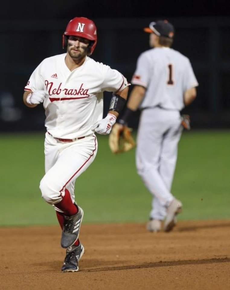Photo -  Nebraska's Aaron Palensky (24) runs the bases after hitting a three-run home run in the first inning of Saturday's late game against Oklahoma State at Chickasaw Bricktown Ballpark. [Nate Billings/The Oklahoman]
