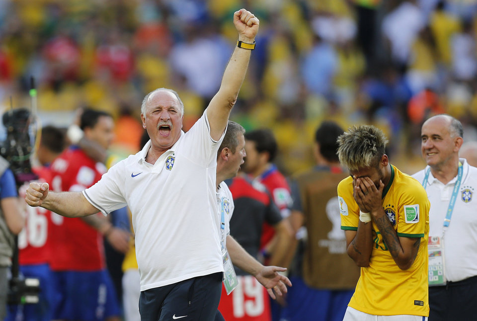 Photo - Brazil's coach Luiz Felipe Scolari, left, and Brazil's Neymar react at the end of the penalties shoot-out during the World Cup round of 16 soccer match between Brazil and Chile at the Mineirao Stadium in Belo Horizonte, Brazil, Saturday, June 28, 2014. Brazil won 3-2 on penalties.(AP Photo/Frank Augstein)
