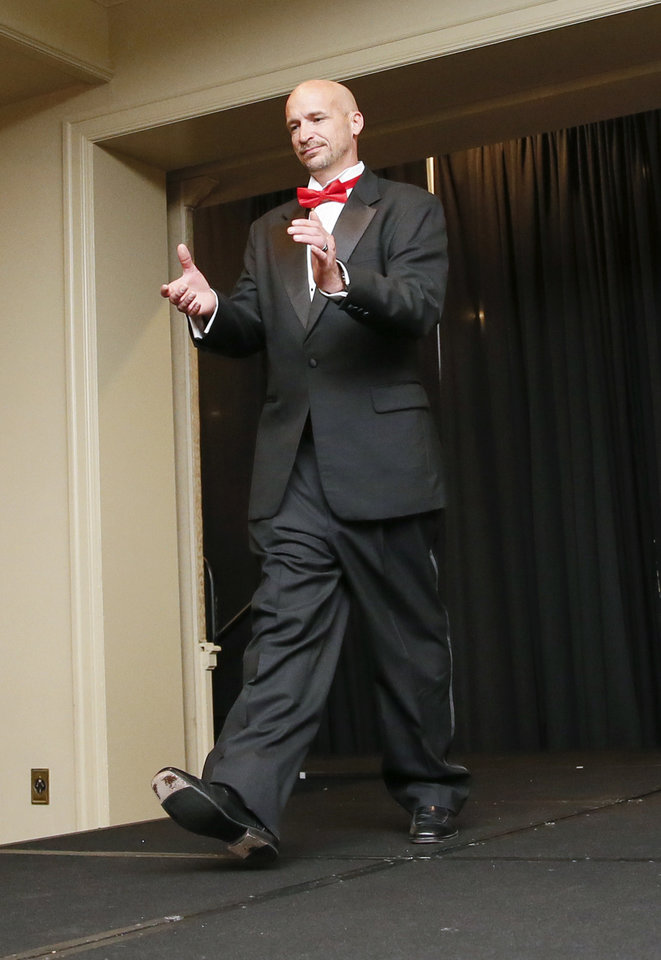 Photo -  Jeramy Woods models formal attire at the