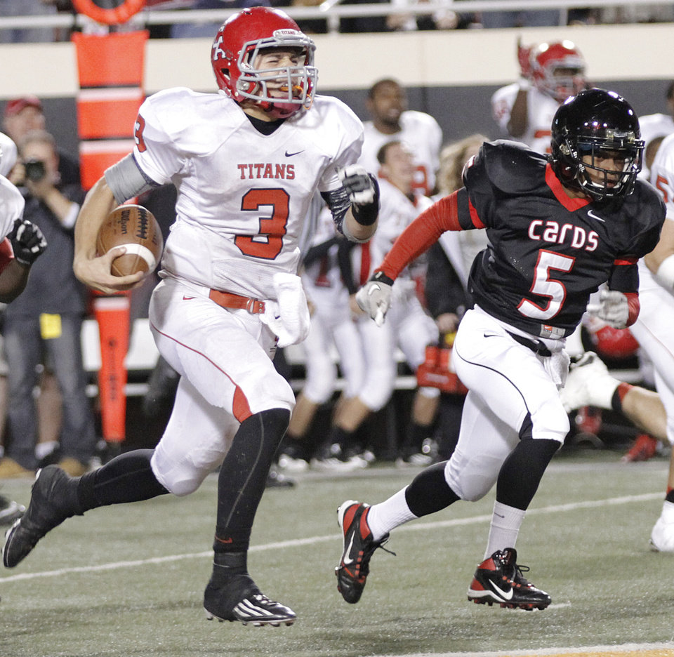 Carl Albert's Steven Thompson (3) out runs East Central's Demeco Bowens (5) during the Class 5A Oklahoma state championship football game between Carl Albert High School and Tulsa East Central High School at Boone Pickens Stadium on Saturday, Dec. 1, 2012, in Stillwater, Okla.   Photo by Chris Landsberger, The Oklahoman