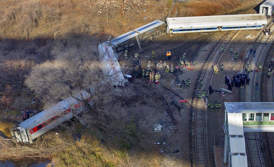 "First responders gather at the derailment of a Metro North passenger train in the Bronx borough of New York Sunday, Dec. 1, 2013  The Fire Department of New York says there are ""multiple injuries"" in the  train derailment, and 130 firefighters are on the scene. Metropolitan Transportation Authority police say the train derailed near the Spuyten Duyvil station. (AP Photo/Craig Ruttle)"