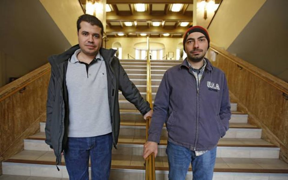 Photo -  University of Oklahoma students Mehmet Demirtas, left, and Gorkem Guloglu are shown recently in Norman. [Photo By Steve Gooch, The Oklahoman]