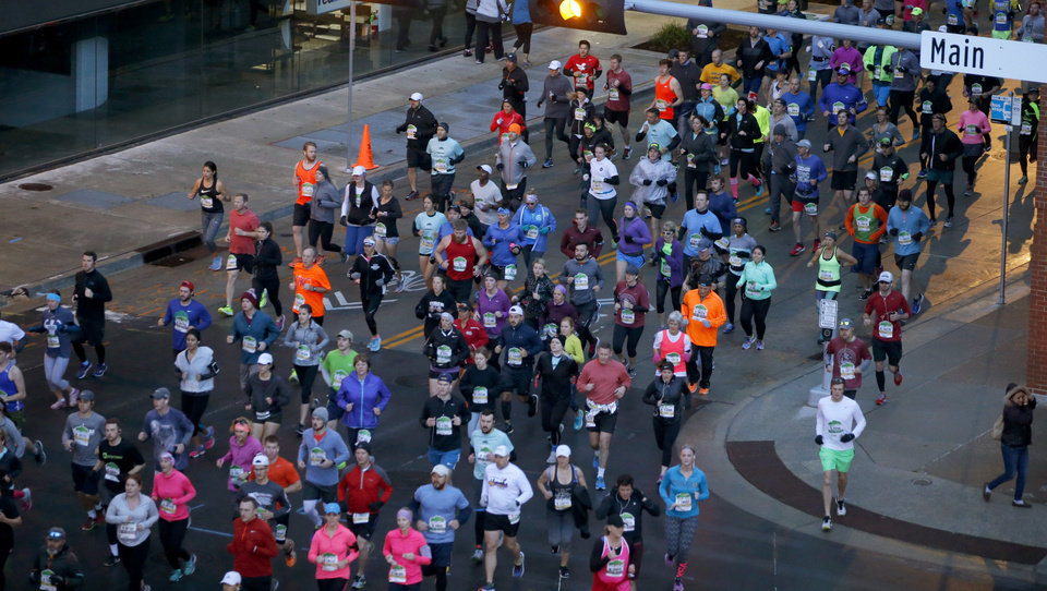 Photo - Runners make their south on Robinson during the Oklahoma City Memorial Marathon in Oklahoma City, Sunday, April 30, 2017. Photo by Bryan Terry, The Oklahoman