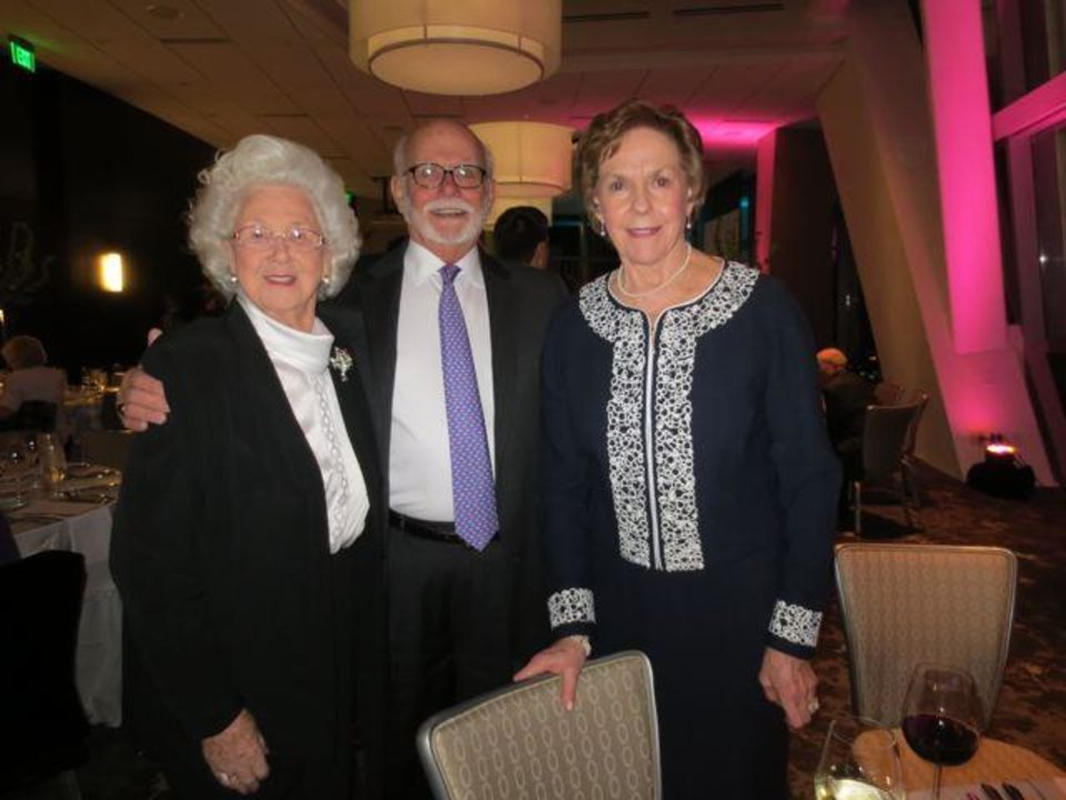 Jose Freede and Don and Carolyn Zachritz were at the Live Auction Benefit at the Devon Energy Center. Anne Barker and Marcy Taber were Dream Co-Chairmen.(Photo by Helen Ford Wallace).