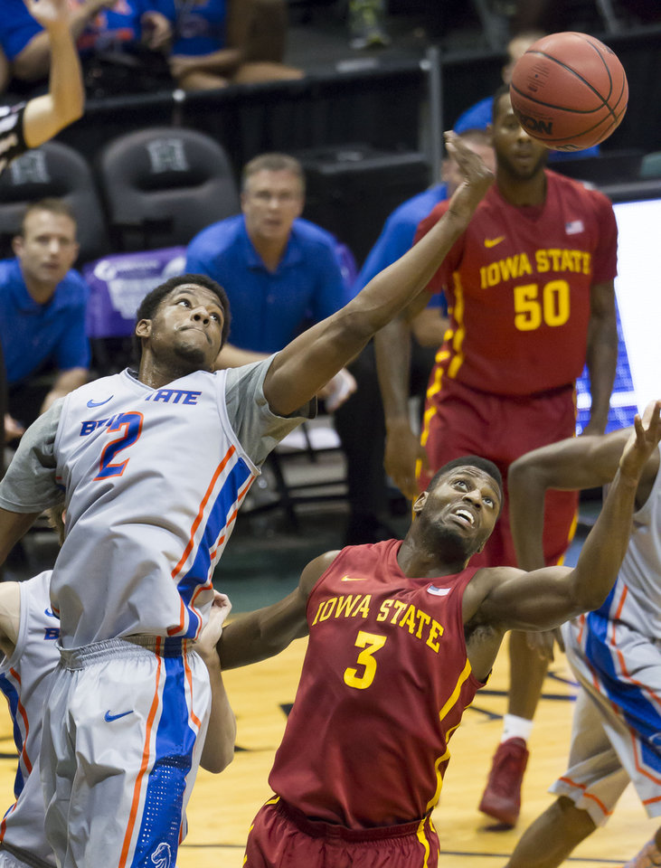 Photo - Boise State guard Derrick Marks (2) reaches out for rebound above Iowa State forward Melvin Ejim (3) during the first half of an NCAA college basketball game at the Diamond Head Classic on Wednesday, Dec. 25, 2013, in Honolulu. (AP Photo/Eugene Tanner)