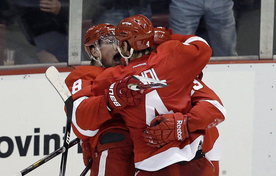 Photo - Detroit Red Wings defenseman Jakub Kindl (4), of the Czech Republic, celebrates his goal against the Chicago Blackhawks during the second period in Game 4 of the Western Conference semifinals in the NHL hockey Stanley Cup playoffs in Detroit, Thursday, May 23, 2013. (AP Photo/Paul Sancya)