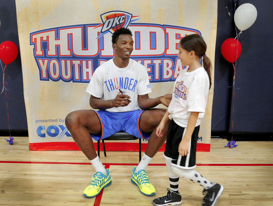 OKC Thunder big man Hasheem Thabeet greeted each camp participant and autographed their jersey before he left the gym after a Thunder Youth Basketball camp Tuesday morning, June 9, 2014, at Santa Fe Family Life Center.   <br /> <br /> At 7-3, Thabeet is the tallest player on the Thunder roster. During his hour-long visit, Thabeet  assisted the campers as they went through some basic   basketball drills. Thunder officials say their camp is designed for kids ages 10 through 16 to hone their basketball skills and build on life lessons such as teamwork, sportsmanship and respect.     <br /> <br /> PHOTO BY JIM BECKEL, The Oklahoman