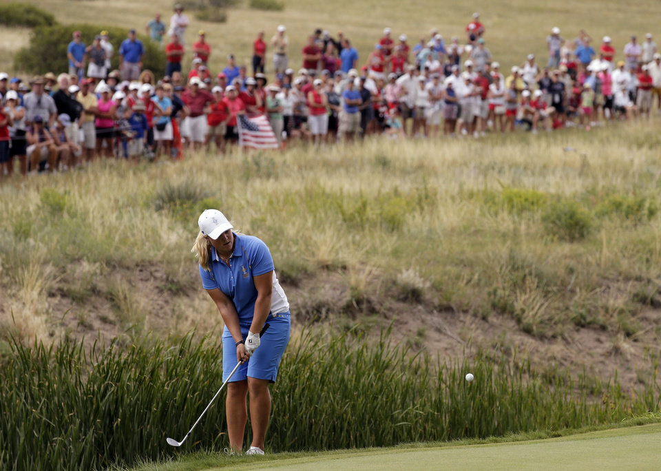 Photo - Europe's Caroline Hedwall, from Sweden, hits to the 16th green during her singles match against United States' Michelle Wie at the Solheim Cup golf tournament on Sunday, Aug. 18, 2013, in Parker, Colo. (AP Photo/Chris Carlson)