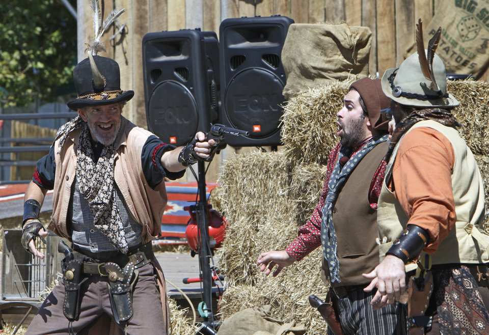 Photo - Gunfight during the Wild West Showcase at the Oklahoma State Fair, Tuesday, September 18, 2012. Photo By David McDaniel/The Oklahoman