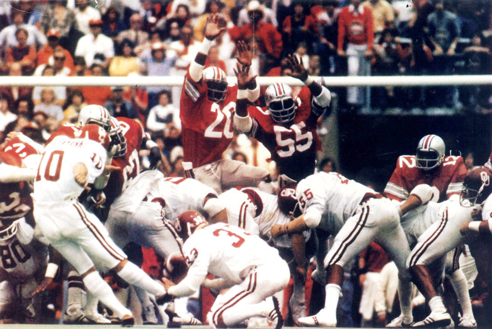 Photo -   In this 1977 photo, University of Oklahoma kicker Uwe von Schamann kicks a game-winning, 41-yard field goal as the Ohio State defense tries to block the kick. Oklahoma claimed a 29-28 win in the game. THE OKLAHOMAN ARCHIVES PHOTO   PROVIDED