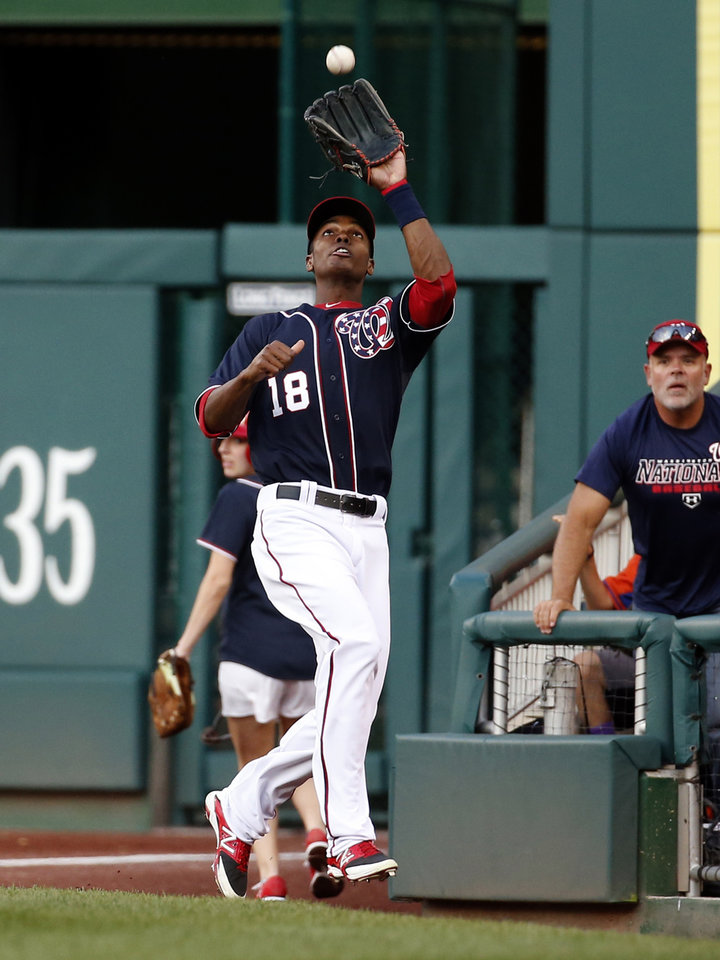 Photo - Washington Nationals right fielder Michael Taylor catches a foul ball hit by Pittsburgh Pirates' Russell Martin during the first inning of a baseball game at Nationals Park, Friday, Aug. 15, 2014, in Washington. (AP Photo/Alex Brandon)