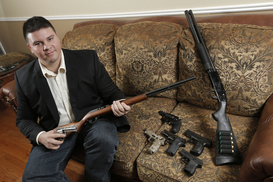 State Sen. Ralph Shortey displays his firearms Sunday at his Oklahoma City home.  Photo by Garett Fisbeck, For The Oklahoman