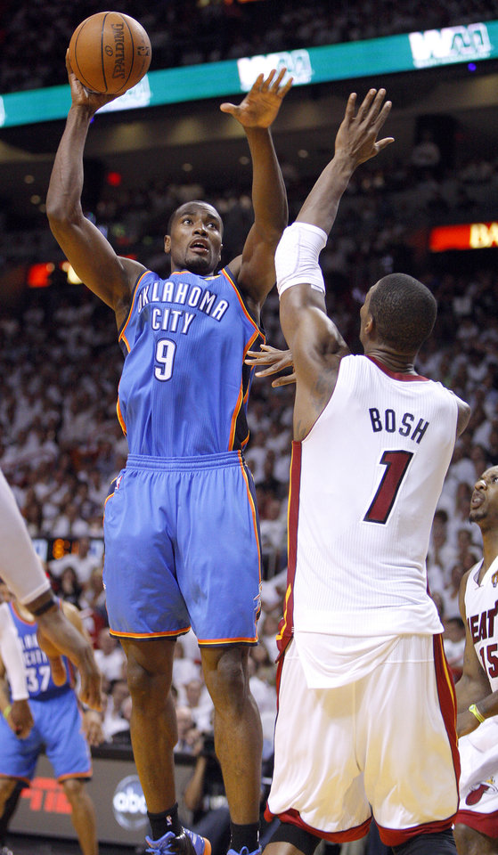 Photo - Oklahoma City's Serge Ibaka (9) shoots over Miami's Chris Bosh (1) during Game 4 of the NBA Finals between the Oklahoma City Thunder and the Miami Heat at American Airlines Arena, Tuesday, June 19, 2012. Photo by Bryan Terry, The Oklahoman