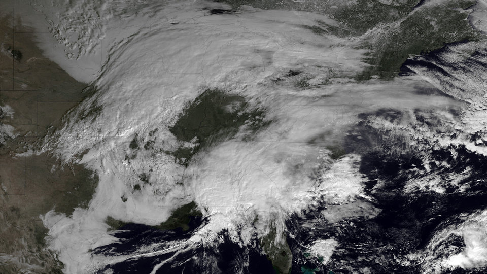 Photo - This image made available by NOAA shows storm systems over the eastern half of the United States on Thursday, Feb. 7, 2013 at 11:15 EST. A blizzard of potentially historic proportions threatened to strike the Northeast with a vengeance Friday, Feb. 8, 2013 with 1 to 2 feet of snow feared along the densely populated Interstate 95 corridor from the New York City area to Boston and beyond. (AP Photo/NOAA)