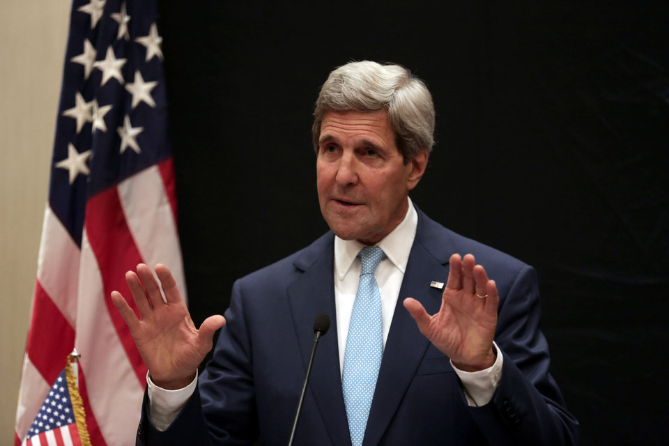 Photo - U.S. Secretary of State John Kerry speaks during a joint news conference with Egyptian Foreign Minister Sameh Shoukry following his meeting with Egyptian President Abdel-Fattah el-Sissi, Sunday, June 22, 2014, in Cairo, Egypt. (AP Photo/Maya Alleruzzo)
