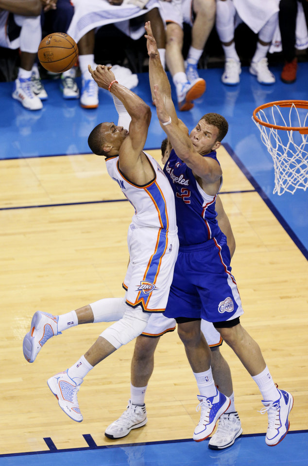 Blake Griffin (32) defends against Russell Westbrook (0) during Game 5 of the Western Conference semifinals in the NBA playoffs between the Oklahoma City Thunder and the Los Angeles Clippers at Chesapeake Energy Arena in Oklahoma City, Tuesday, May 13, 2014. Photo by Bryan Terry, The Oklahoman