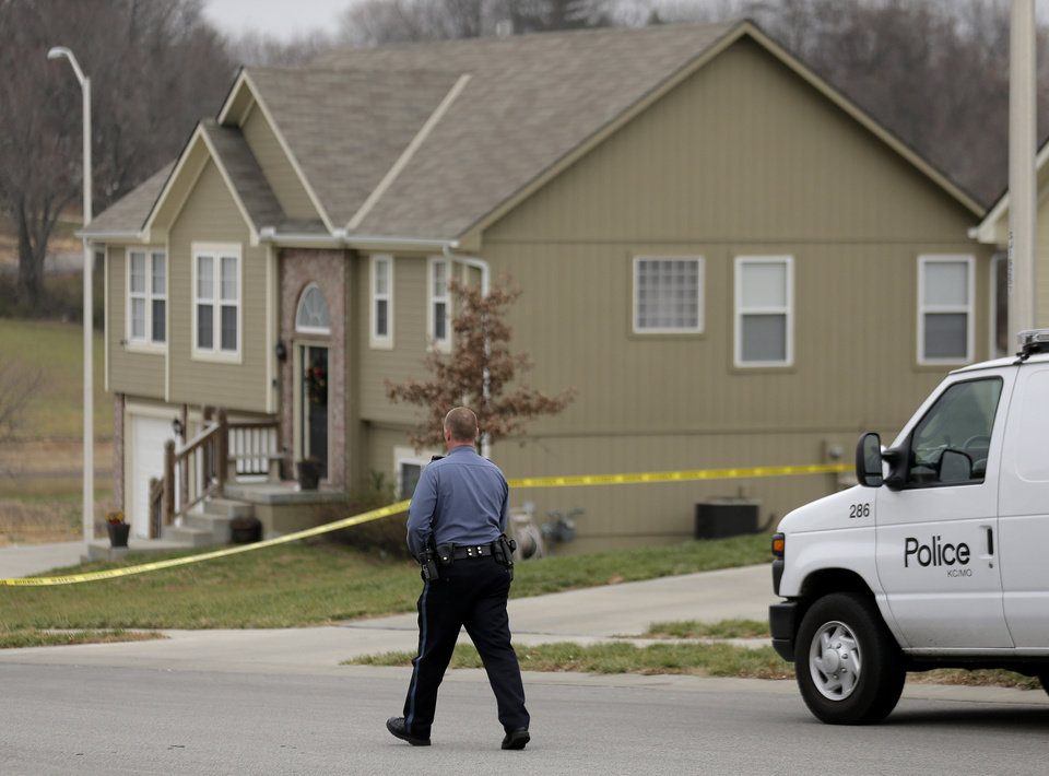 A police officer walks to an Independence, Mo., house house where police say Kansas City Chiefs linebacker Jovan Belcher fatally shot his girlfriend before driving to the NFL football team's training facility and shooting himself, Saturday, Dec. 1, 2012. (AP Photo/Charlie Riedel)