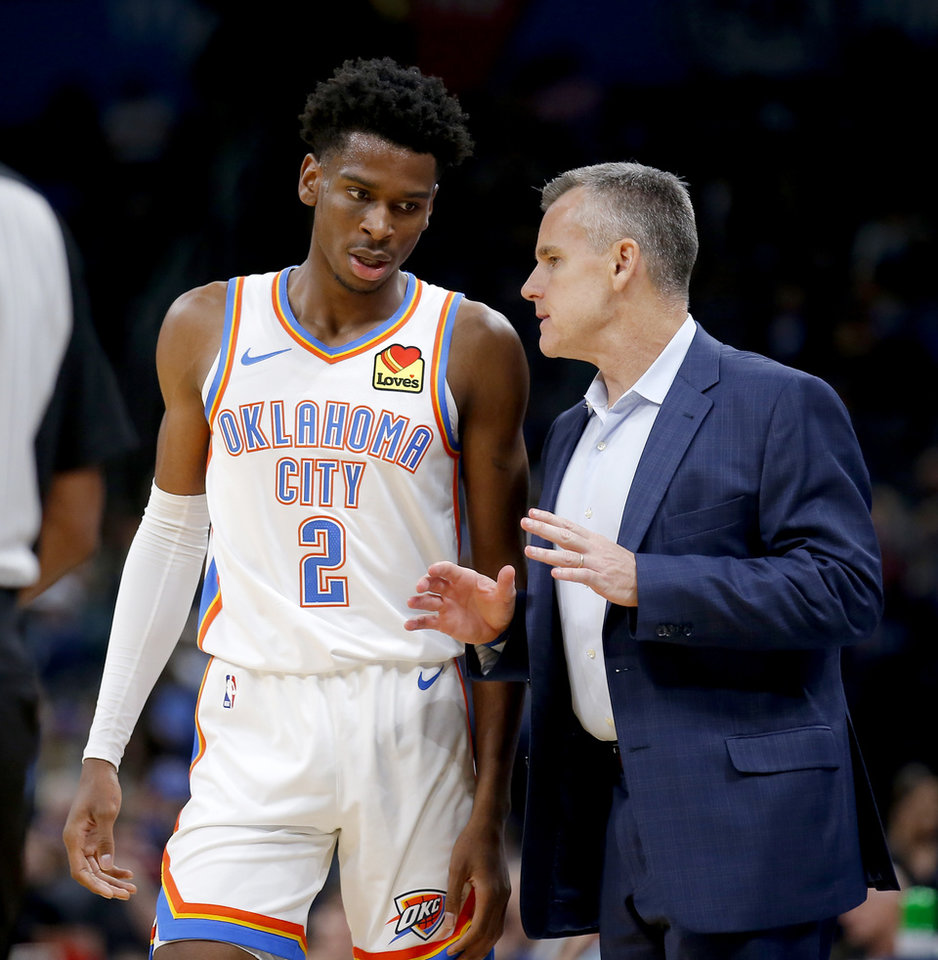 Photo - Oklahoma head coach Billy Donovan talks with Shai Gilgeous-Alexander (2) during the NBA preseason game between the Oklahoma City Thunder and the New Zealand Breakers at the Chesapeake Energy , Thursday, Oct. 10, 2019. [Sarah Phipps/The Oklahoman]