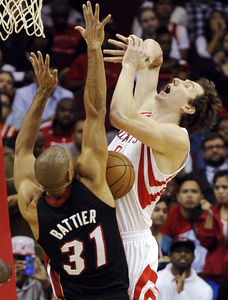 Houston Rockets' Omer Asik, right, loses the ball under pressure from Miami Heat's Shane Battier (31) in the first half of an NBA basketball game, Monday, Nov. 12, 2012, in Houston. (AP Photo/Pat Sullivan)