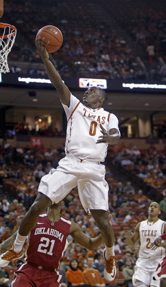 Photo - Texas guard Kendal Yancy lays the ball up during the first half of an NCAA college basketball game against Oklahoma, Saturday, Jan. 4, 2014, in Austin, Texas. (AP Photo/Michael Thomas)