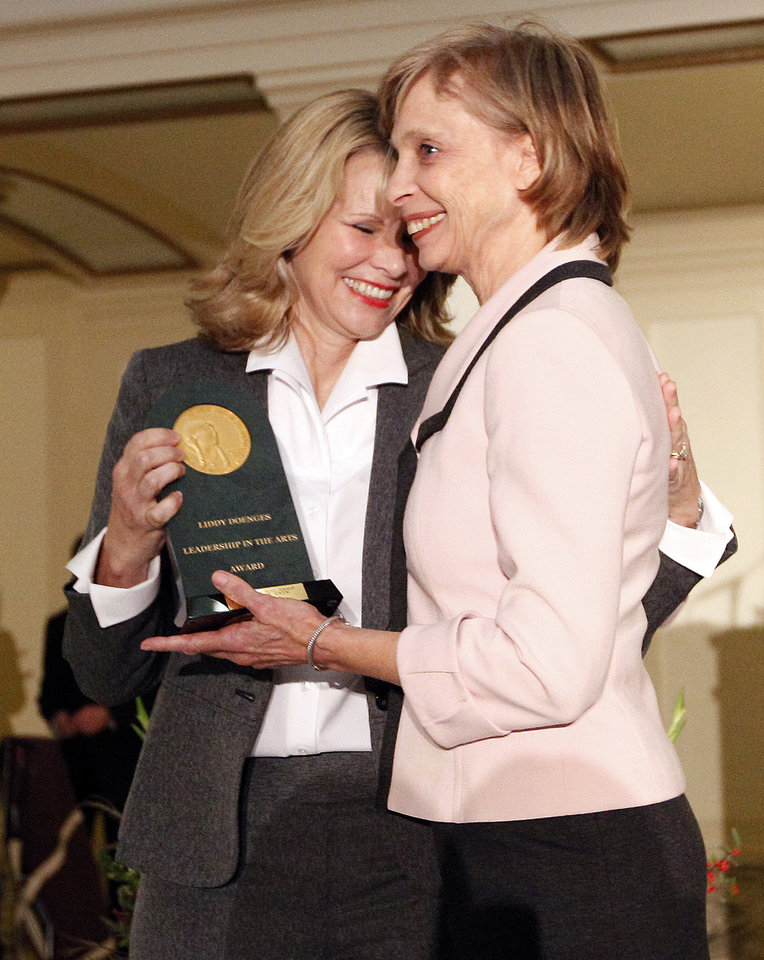 Photo - Kim Baker presents the Liddy Doenges Leadership in the Arts Award to Suzanne Tate during the Oklahoma Arts Council 36th Annual Governor's Arts Awards at the state Capitol in Oklahoma City,  Tuesday, Nov. 15, 2011.  Photo by Sarah Phipps, The Oklahoman ORG XMIT: KOD