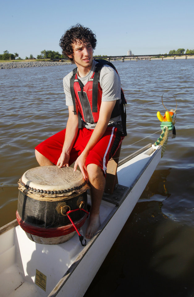 Kolten Kendall, 17, from Mona, Utah, sits in the drummer's seat in a dragon boat while on the Oklahoma River during Four Star Leadership summer camp in Oklahoma City Thursday, July 19, 2012.  Photo by Paul B. Southerland, The Oklahoman