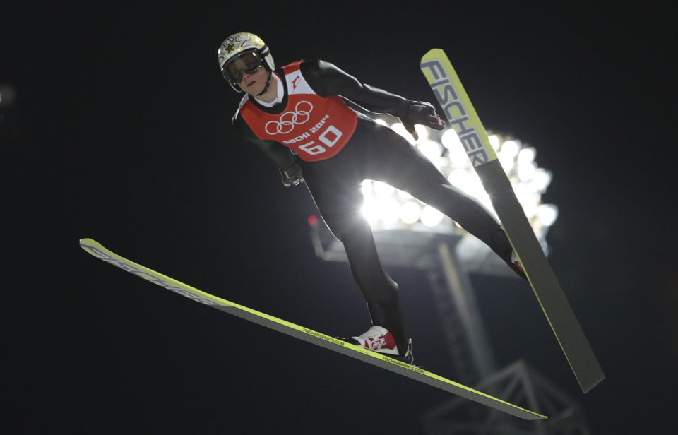 Photo - Austria's Thomas  Morgenstern makes an attempt in the men's normal hill ski jumping training at the 2014 Winter Olympics, Thursday, Feb. 6, 2014, in Krasnaya Polyana, Russia. (AP Photo/Matthias Schrader)