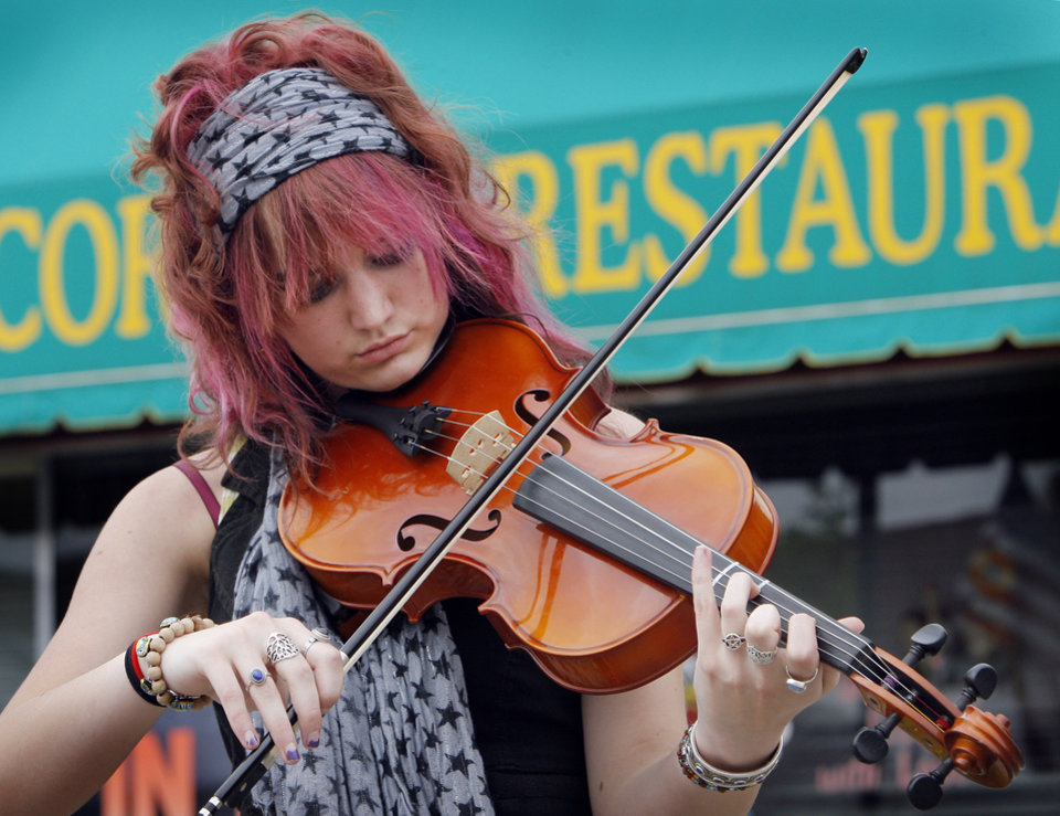 Photo - Megan Harris plays her violin at the Downtown Edmond Arts Festival, Friday, May 1, 2009.   Photo By David McDaniel, The Oklahoman