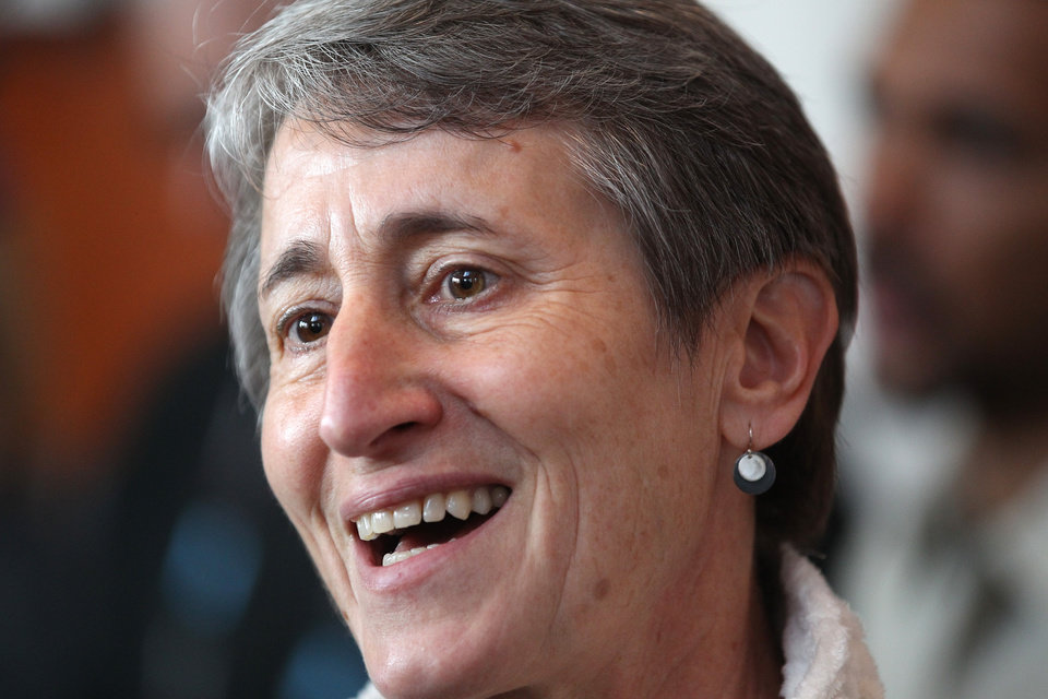 Photo - Secretary of the Interior Sally Jewell speaks reporters during a trade show for outdoor gear makers Wednesday, Jan. 22, 2014, in Salt Lake City. Jewell made a pitch Wednesday for a privately funded youth conservation corps and sought donations for the effort from executives at an outdoor-gear trade show. (AP Photo/Rick Bowmer)