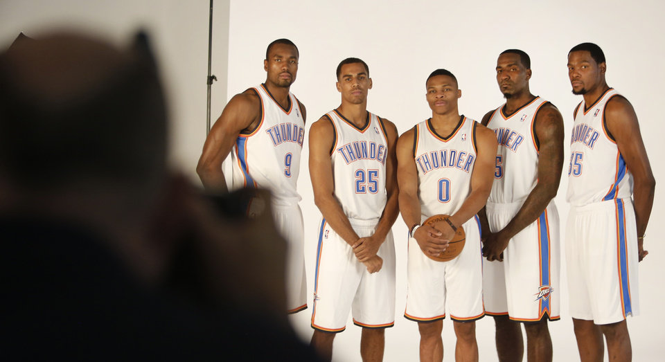 Serge Ibaka, Thabo Sefolosha, Russell Westbrook, Kendrick Perkins and Kevin Durant pose for photos during media day with the Oklahoma City Thunder in Oklahoma City, Thursday September  27, 2013. Photo By Steve Gooch, The Oklahoman