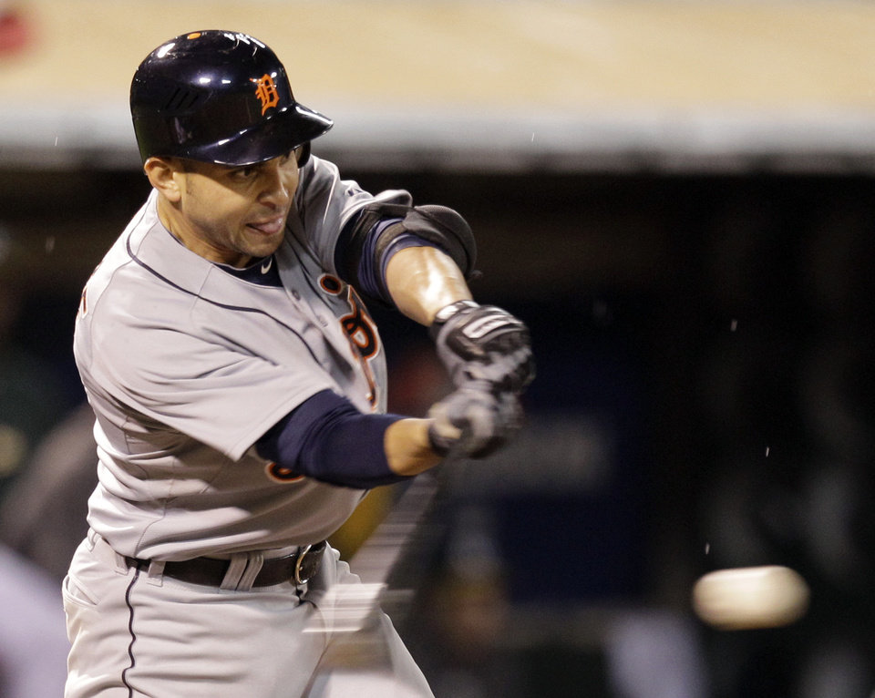 Detroit Tigers Omar Infante hits a single in the eighth inning of Game 4 of an American League division baseball series against the Oakland Athletics in Oakland, Calif., Wednesday, Oct. 10, 2012. (AP Photo/Ben Margot)