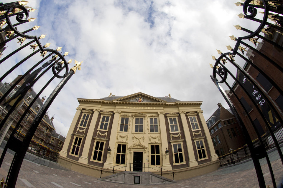 Photo - Exterior view of the renovated Mauritshuis museum during a preview for the press in The Hague, Netherlands, Friday, June 20, 2014. The Mauritshuis reopens after a two-year renovation that allowed its masterpieces, including Vermeer's The Girl with the Pearl Earring to be seen by record-setting crowds abroad. The public will have access for free from 8 pm till midnight on Friday June 27th after the official ceremonial opening and from June 28 onwards the museum will revert to regular opening hours. (AP Photo/Peter Dejong)