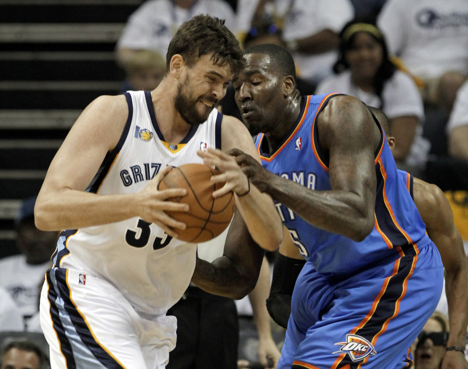 Photo - Memphis Grizzlies center Marc Gasol (33), of Spain, drives against Oklahoma City Thunder center Kendrick Perkins (5) during the first half of Game 3 of a second-round NBA basketball series on Saturday, May 7, 2011, in Memphis, Tenn. (AP Photo/Lance Murphey)