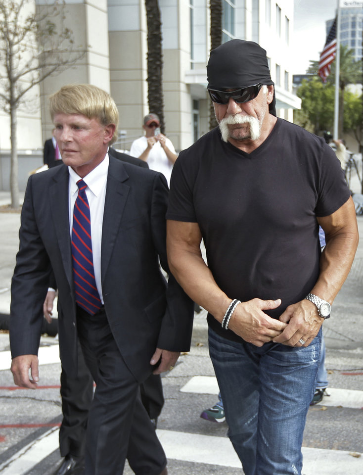 Photo -   Reality TV star and former pro wrestler Hulk Hogan, right, whose real name is Terry Bollea, leaves the United States Courthouse with his attorney David Houston after a news conference Monday, Oct. 15, 2012 Tampa, Fla. Hogan says he was secretly taped six years ago having sex with the ex-wife of DJ Bubba
