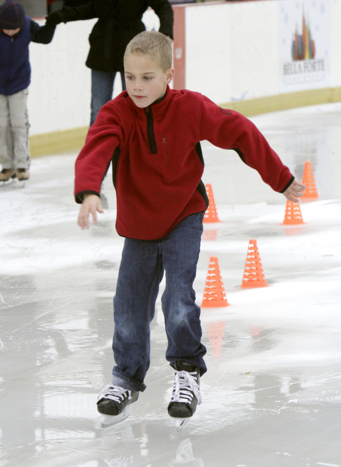 Seven-year-old Fred DeGrace does his best to keep his balance, as an outdoor skating rink opens at Edmond's Festival Market Place in Edmond, OK, Friday, Nov. 25, 2011. By Paul Hellstern, The Oklahoman