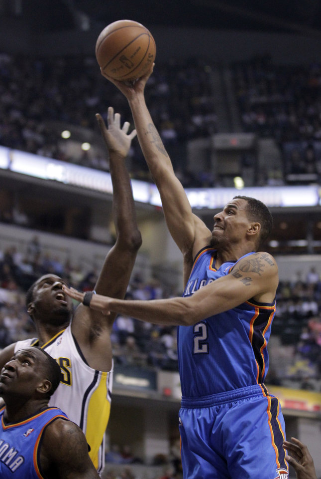 Oklahoma City Thunder guard Thabo Sefolosha, right, shoots over Indiana Pacers center Roy Hibbert in the first half of an NBA basketball game in Indianapolis, Friday, April 6, 2012. (AP Photo/Michael Conroy) ORG XMIT: NAF104