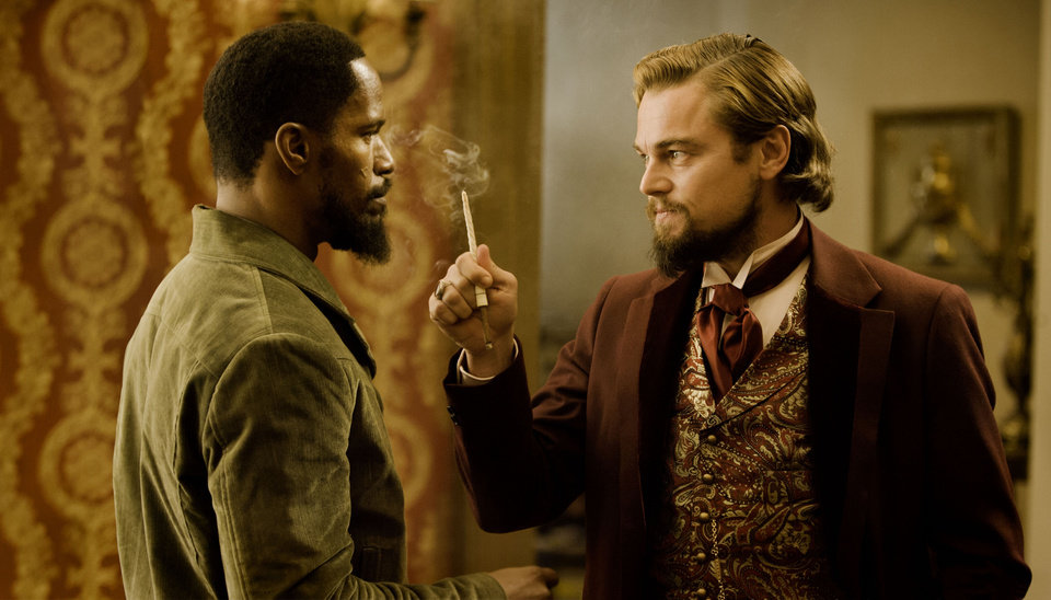 Jamie Foxx as Django, left, and Leonardo DiCaprio as Calvin Candle star in the film,