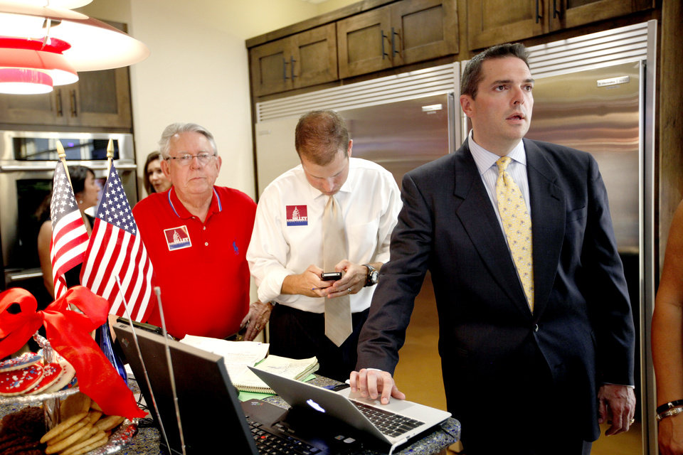 Photo - Sen. Clark Jolley checks results during a watch party in Edmond, Okla. Tuesday, June 26, 2012. Photo by Sarah Phipps, The Oklahoman
