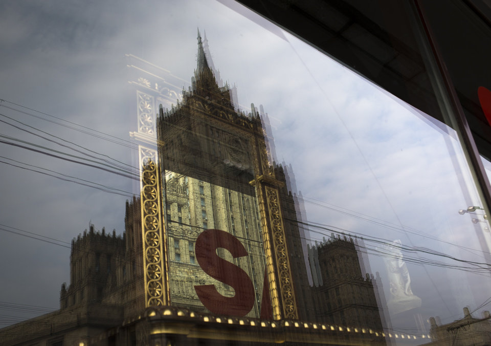 Photo -   The Russian Foreign Ministry headquarters seen reflected in a shop window in Moscow on Thursday, Oct. 4, 2012. US prosecutors allege that naturalized U.S. citizen Alexander Fishenko and six others