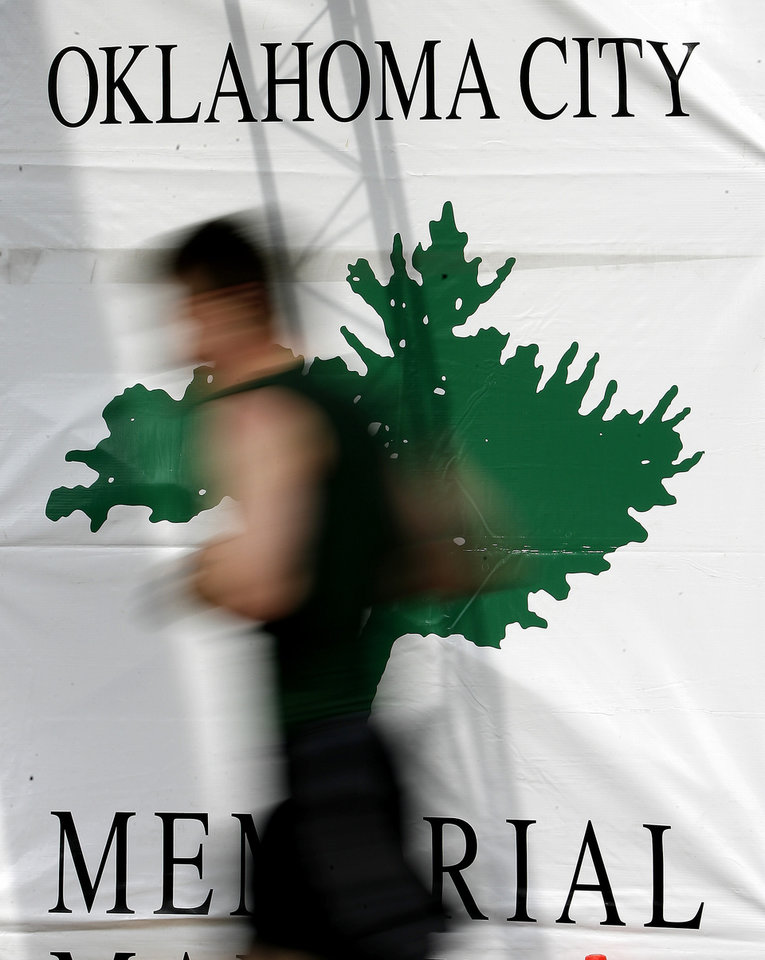 A runner passes by the finish line at the Oklahoma City Memorial Marathon, Sunday, April 27, 2008.  BY BRYAN TERRY, THE OKLAHOMAN