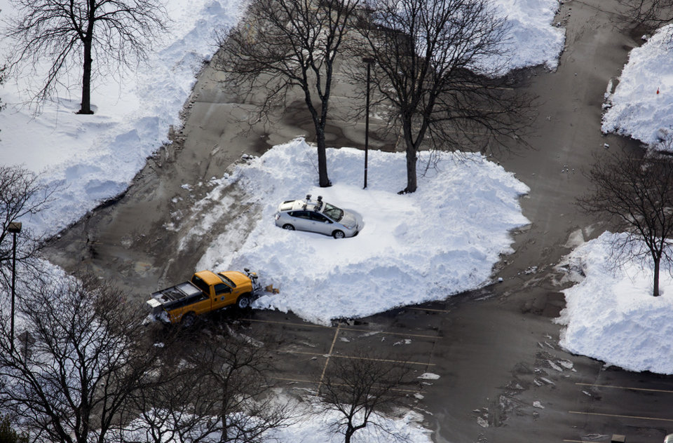 Photo - A car in a Hamden, Connecticut parking lot is isolated by snow Sunday, Feb. 10, 2013, in the aftermath of a storm that hit Connecticut and much of the New England states. (AP Photo/Craig Ruttle)