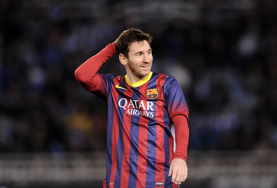 Photo - FC Barcelona's Lionel Messi of Argentina, gestures during their Spanish Copa del Rey semifinal second leg soccer match against Real Sociedad, at Anoeta stadium, in San Sebastian northern Spain, Wednesday, Feb. 12, 2014. (AP Photo/Alvaro Barrientos)
