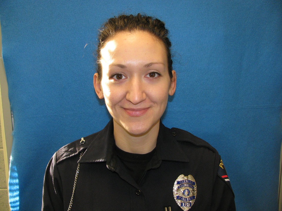 Photo - This undated photo provided by the Wauwatosa Police Department shows officer Jennifer L. Sebena, who was found shot to death Monday, Dec. 24, 2012. Police on Tuesday released a statement saying they're pursuing multiple leads. (AP Photo/Wauwatosa Police Department)