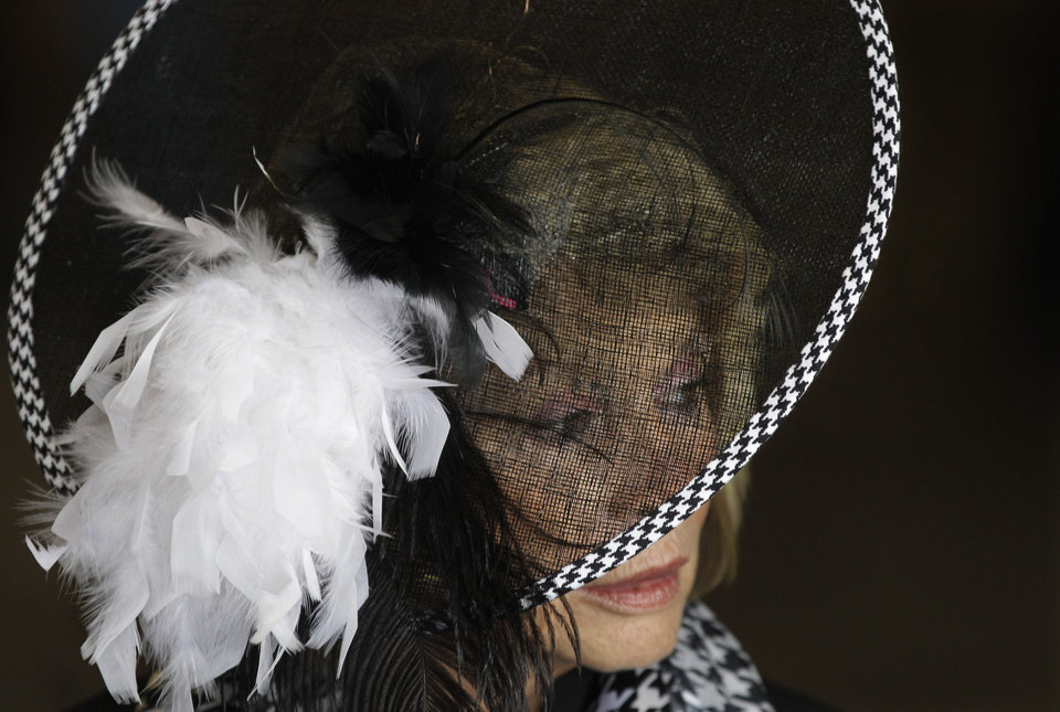 Photo - Dawn Paden, from Mountain Home, Ark., wears a fancy hat in the paddock before the 138th Kentucky Derby horse race at Churchill Downs Saturday, May 5, 2012, in Louisville, Ky. (AP Photo/Mark Humphrey)  ORG XMIT: DBY113