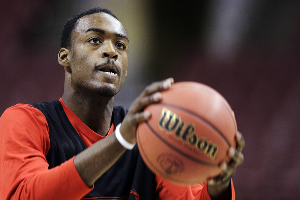 San Diego State\'s Jamaal Franklin sets to shoot during practice for a second-round game of the NCAA college basketball tournament, Thursday, March 21, 2013, in Philadelphia. San Diego State is scheduled to play Oklahoma Friday. (AP Photo/Matt Slocum) ORG XMIT: PXC122