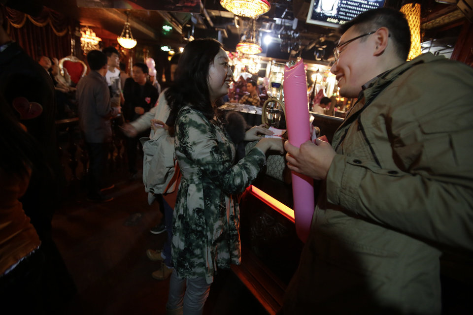 "A man and woman participants chat during a matchmaking party organized by one of the biggest Chinese matchmaking websites in Shanghai, China on Sunday Nov. 11, 2012. Singles Day was begun by Chinese college students in the 1990s as a version of Valentine's Day for people without romantic partners. The timing was based on the date Nov. 11, or ""11.11"" � four singles. Unattached young people would treat each other to dinner or give gifts to woo that special someone and end their single status. (AP Photo/Eugene Hoshiko)"