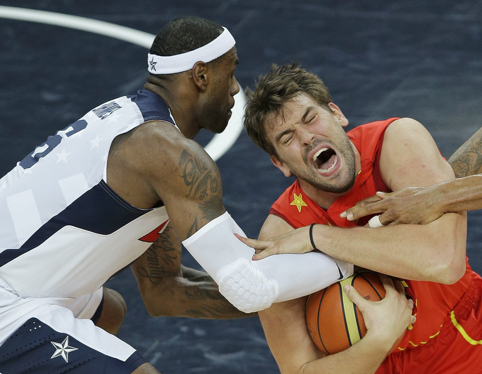 Spain's Marc Gasol and United States' LeBron James battle for a loose ball during the men's gold medal basketball game at the 2012 Summer Olympics, Sunday, Aug. 12, 2012, in London. (AP Photo/Matt Slocum)