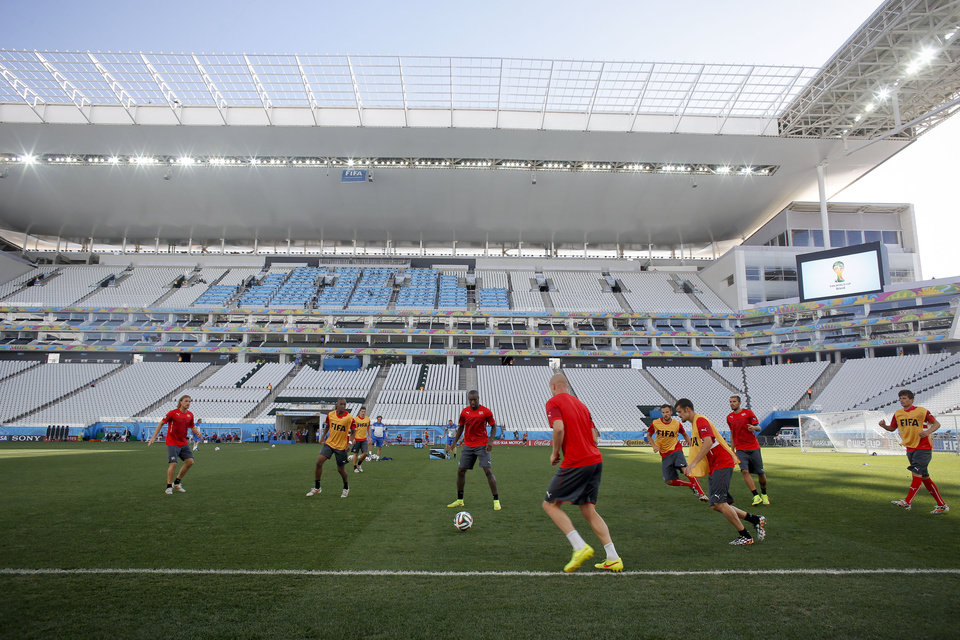 Photo - Switzerland's players take part in a training session at Itaquerao Stadium in Sao Paulo, Brazil, Monday, June 30, 2014.  On Tuesday, Switzerland will face Argentina in their next World Cup soccer match. (AP Photo/Victor R. Caivano)