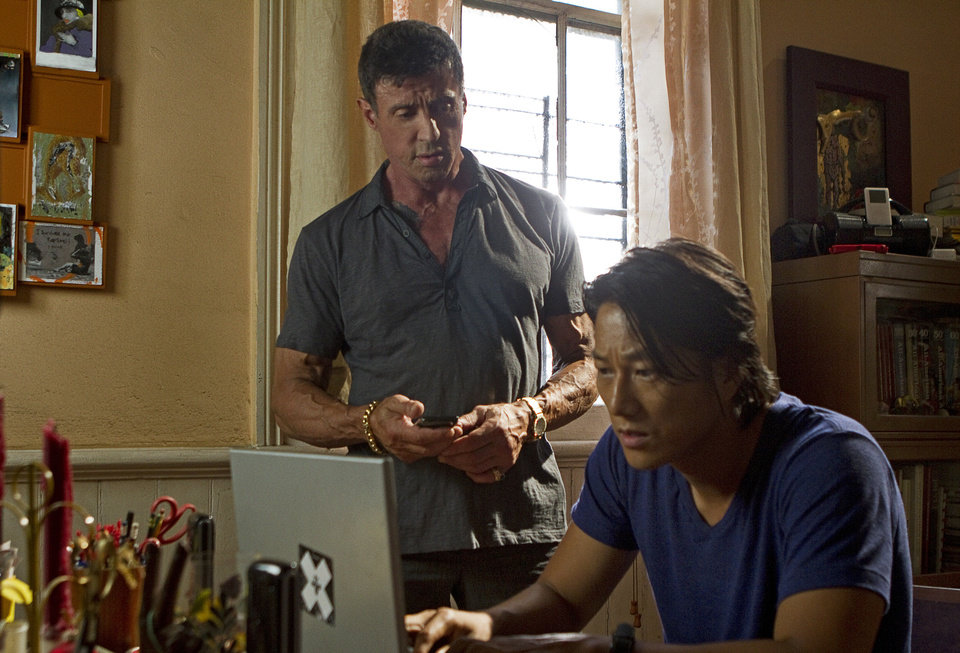 Photo - This film image released by Warner Bros. Pictures shows Sylvester Stallone, left, and Sung Kang in a scene from