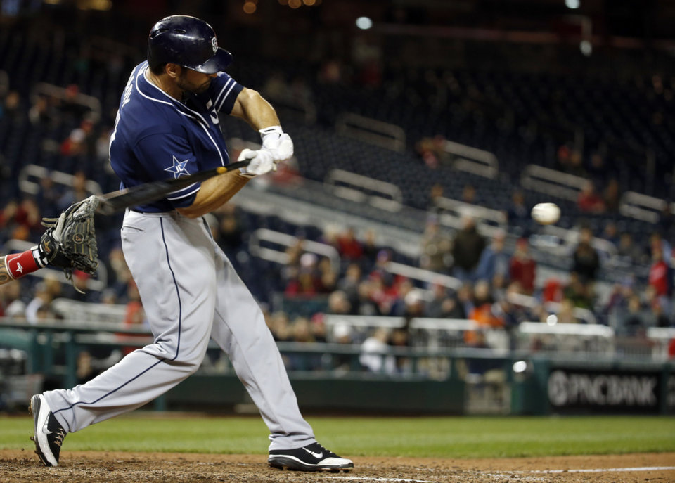 Photo - San Diego Padres' Xavier Nady hits an RBI single to score the winning during the 12th inning of a baseball game against the Washington Nationals at Nationals Park on Thursday, April 24, 2014, in Washington. The Padres won 4-3 in 12 innings. (AP Photo/Alex Brandon)